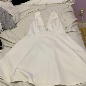 Deep V white mini dress